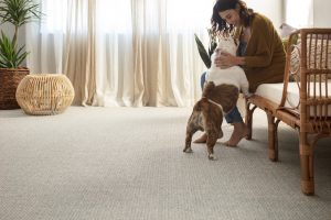 Woman with dog on Carpet | Neils Floor Covering