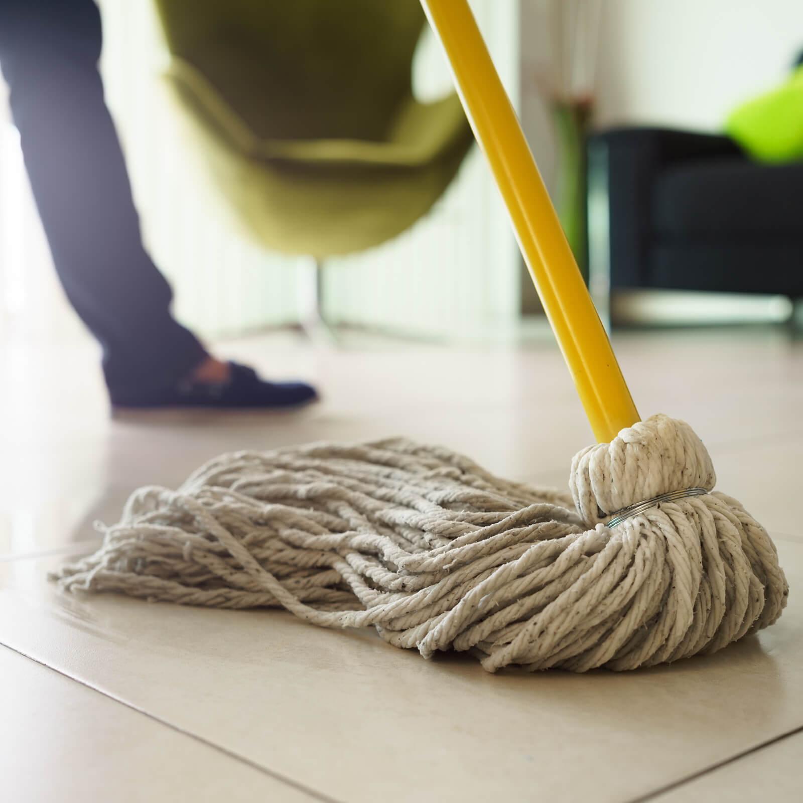 Mopping tile flooring | Neils Floor Covering