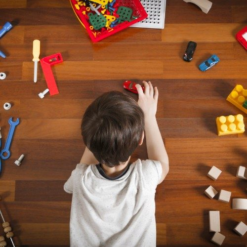 Child playing with toys on luxury vinyl flooring | Neils Floor Covering